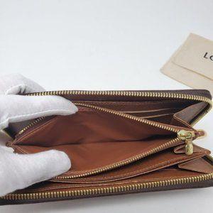 Louis Vuitton Bags - 100% Auth Louis Vuitton Monogram Zippy Wallet